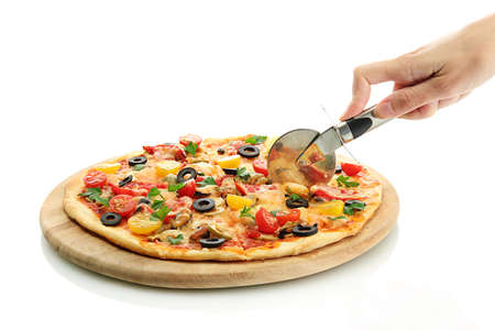 woman's hand with a knife cut the pizza on white background close-up Stock Photo - 15414335