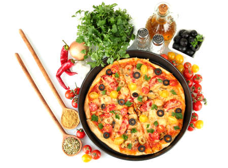 colorful composition of delicious pizza, vegetables and spices on white background close-up photo