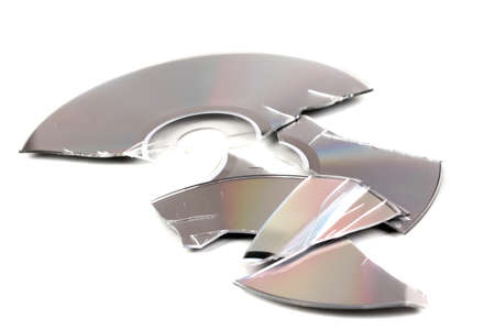 compromising: Broken disk with information isolated on white Stock Photo