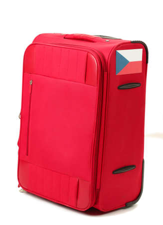 carryall: red suitcase with sticker with flag of Czech Republic isolated on white
