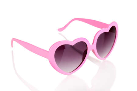 Pink heart-shaped sunglasses isolated on white Stock Photo - 15424417