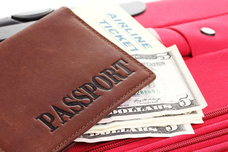 Passport and ticket on suitecase close-up Stock Photo - 15424415