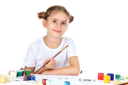 Cute little girl painting a picture, isolated on white photo