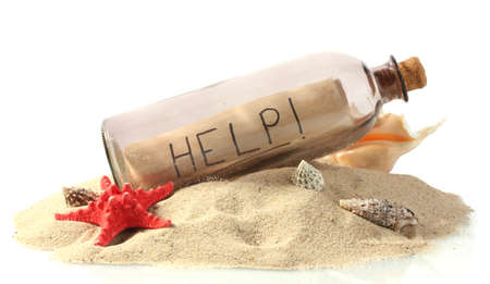 Glass bottle with note inside on sand isolated on white Stock Photo - 15444010