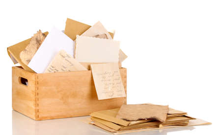 Wooden crate with papers and letters isolated on white Stock Photo - 15443963
