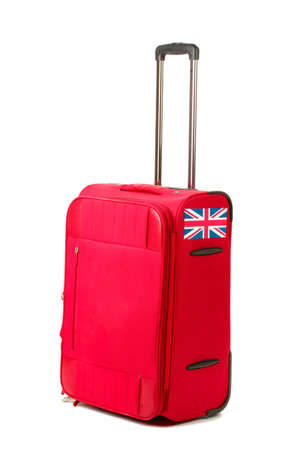 red suitcase with sticker with flag of United Kingdom isolated on white