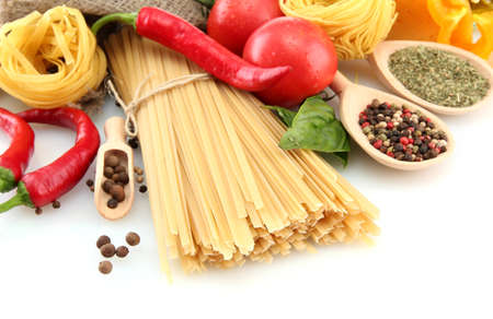 Pasta spaghetti, vegetables and spices, isolated on white Stock Photo - 15444051