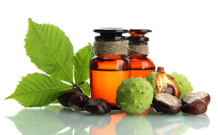 medicine bottles with chestnuts and leaves, isolated on white photo
