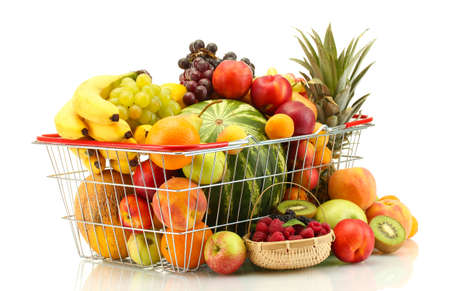 Assortment of exotic fruits in metal basket isolated on white photo