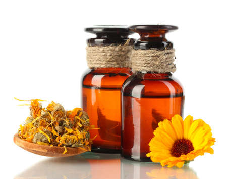 healing plant: medicine bottles and calendula, isolated on white