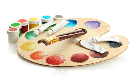 wooden art palette with paint and brushes isolated on white Stock Photo - 15455984
