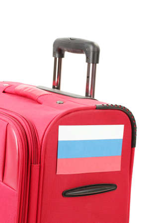 red suitcase with sticker with flag of Russian Federation isolated on white photo