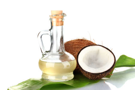 decanter with coconut oil and coconuts isolated on white Stock Photo - 15455977