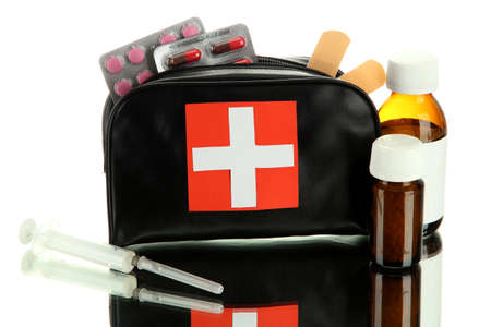 First aid bag, isolated on white photo