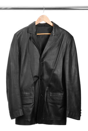 black leather Jacket on  wooden hanger, isolated on white photo