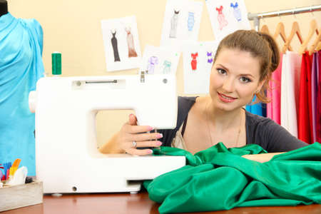 sewing pattern: beautiful young dressmaker in workroom Stock Photo