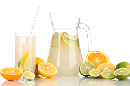 Citrus lemonade in pitcher and glass of citrus around isolated on white Stock Photo - 15455854