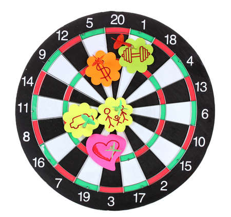 holed: Darts with stickers depicting the life values isolated on white. The darts hit the target. Stock Photo