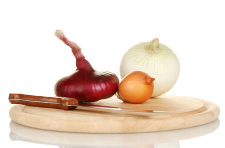 different types of onions on a cutting board isolated on white photo