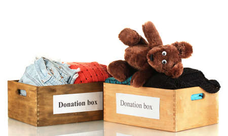 Donation boxes with clothing isolated on white photo
