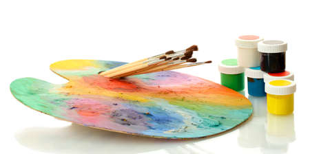 wooden art palette with paint and brushes isolated on white Stock Photo - 15536386