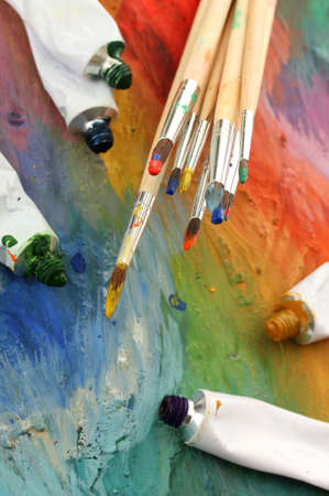 acrylic paint, paint tubes and brushes on wooden palette Stock Photo - 15537945