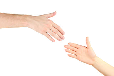 Womens hand goes to the mans hand on white background photo