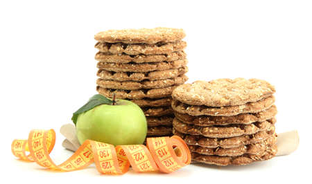 tasty crispbread, apple and measuring tape, isolated on white Stock Photo - 15536545
