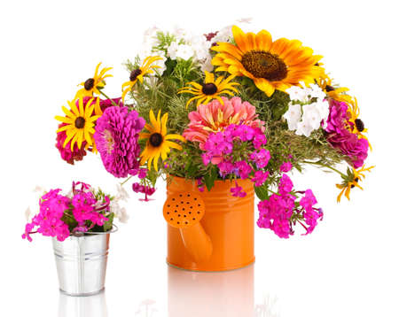Beautiful bouquet of bright flowers in bailer isolated on white photo