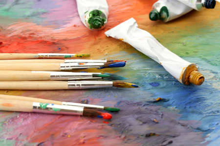 acrylic paint, paint tubes and brushes on wooden palette Stock Photo - 15602565