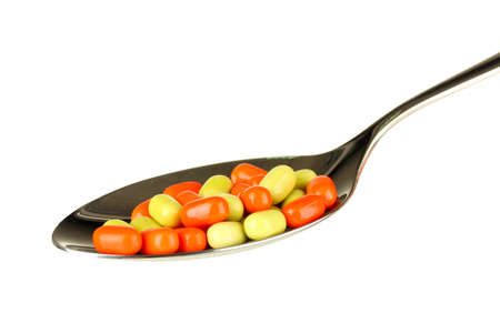 colorful pills on spoon on white background close-up Stock Photo - 15590226