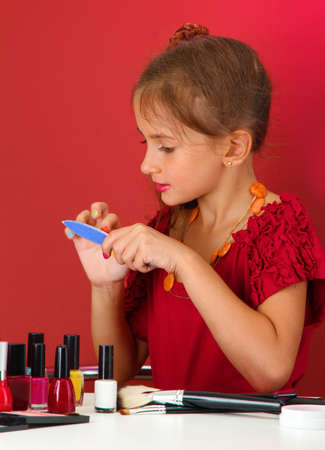 little girl in her mothers dress with manicure photo