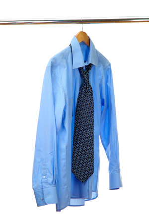 blue shirt with tie on wooden hanger isolated on white Stock Photo - 15601083