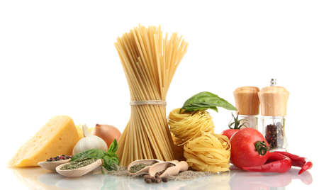 Pasta spaghetti, vegetables and spices, isolated on white photo