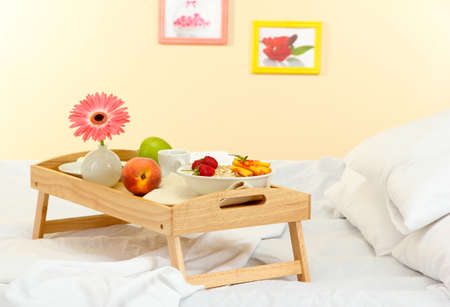 wooden tray with light breakfast on bed Stock Photo - 15601266