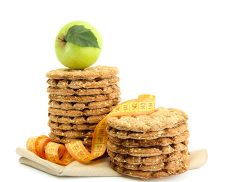 galettes: tasty crispbread, apple and measuring tape, isolated on white Stock Photo