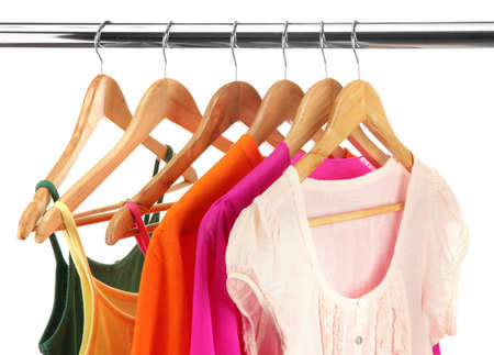 hangs: different clothes on wooden hangers isolated on white