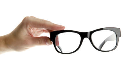 woman hand with black glasses, isolated on white photo