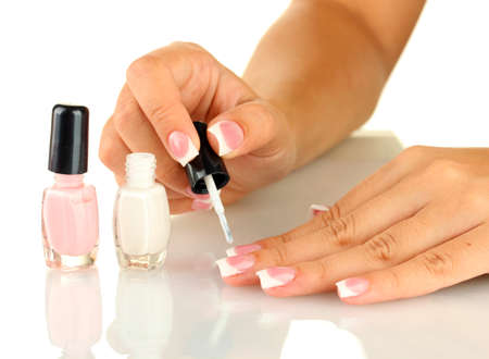 Woman makes herself a French manicure, on white background Stock Photo - 15609323