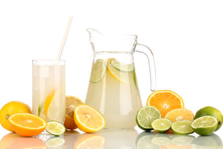 Citrus lemonade in pitcher and glass of citrus around isolated on white Stock Photo - 15609311