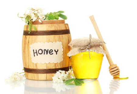 Sweet honey in barrel and jar with acacia flowers isolated on white Stock Photo - 15641885
