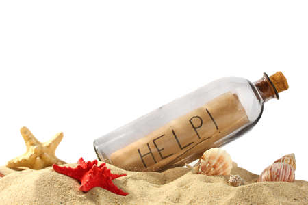 castaway: Glass bottle with note inside on sand isolated on white Stock Photo