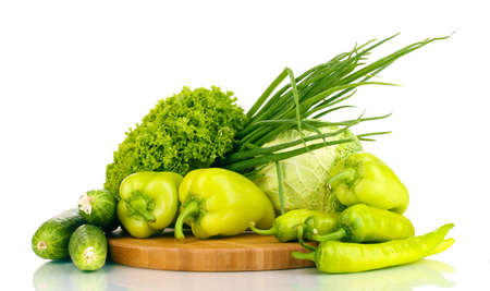 fresh green vegetables on chopping board isolated on white Stock Photo - 15616563