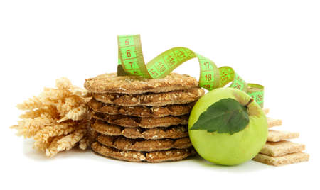 tasty crispbread, apple, measuring tape and ears, isolated on white Stock Photo - 15616419