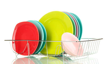 Color plates in rack isolated on white photo