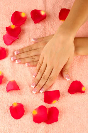woman's hands on pink terry towel, close-up photo