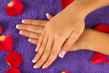 woman's hands on purple terry towel, close-up photo