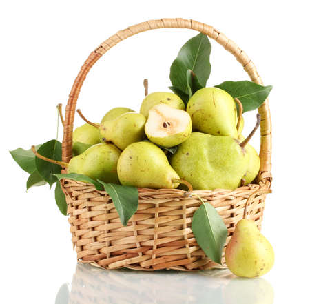 Juicy flavorful pears in basket isolated on white photo