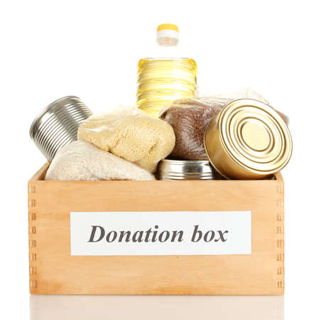 canned food: Donation box with food isolated on white