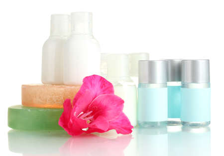 lotion bottle: cosmetic bottles, soap and flower, isolated on white